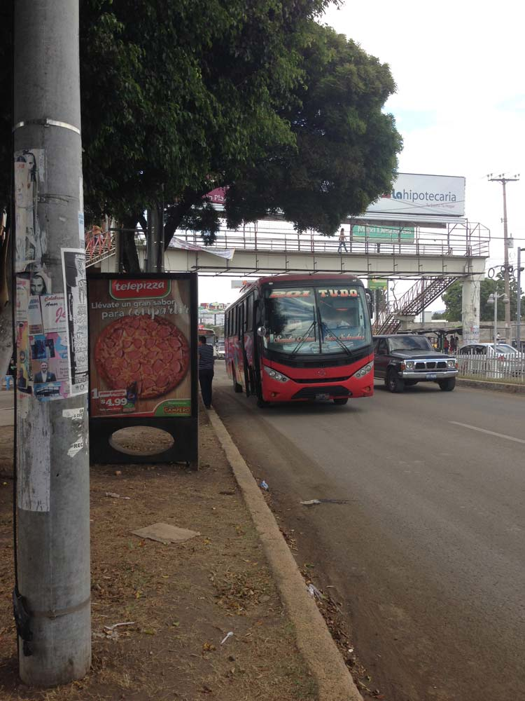 TUDO bus passing the metrocentro in Santa Ana, El Salvador
